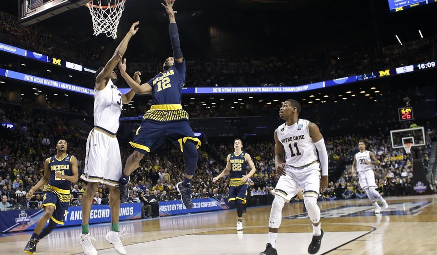 Michigan's Muhammad-Ali Abdur-Rahkman (12) drives past Notre Dame's V.J. Beachem (3) during the first half of a first-round men's college basketball game in the NCAA Tournament, Friday, March 18, 2016, in New York. (AP Photo/Frank Franklin II)