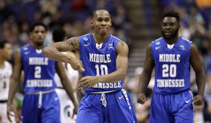 Middle Tennessee's Jaqawn Raymond (10) celebrates after making a basket during the first half of a first-round men's college basketball game against Michigan State in the NCAA Tournament, Friday, March 18, 2016, in St. Louis. (AP Photo/Charlie Riedel)