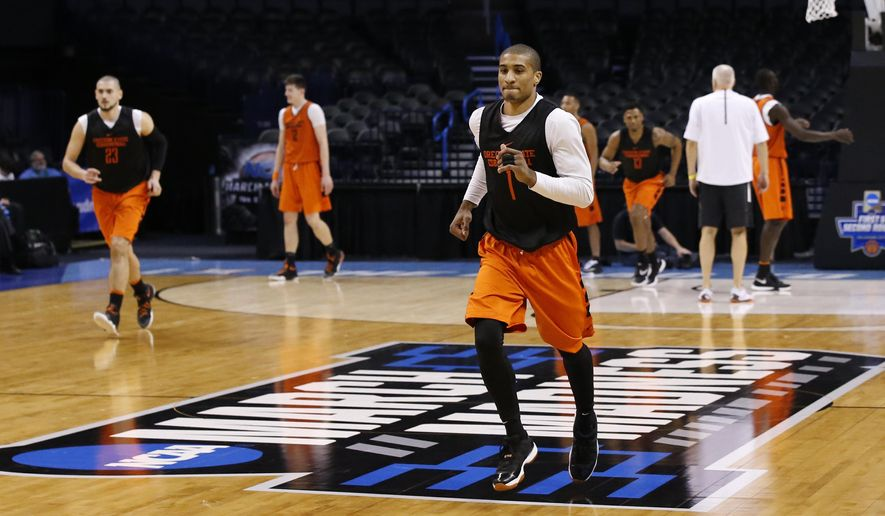 Oregon State guard Gary Payton II (1) runs during a drill during a practice for a first round men's college basketball game in the NCAA Tournament, Thursday, March 17, 2016, in Oklahoma City. (AP Photo/Sue Ogrocki)