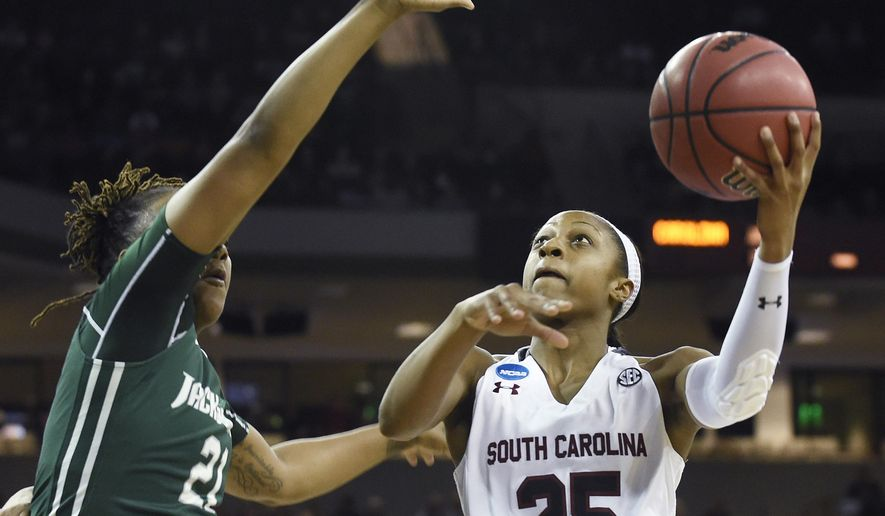 South Carolina guard Tiffany Mitchell (25) goes for a shot as Jacksonville forward Christin Mercer (21) defends during a first-round women's college basketball game in the NCAA Tournament on Friday, March 18, 2016, in Columbia, S.C. (AP Photo/Rainier Ehrhardt)