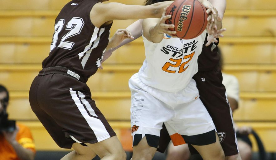 St. Bonaventure's Miranda Drummond, left, tries to take the ball from Oklahoma State's Brittany Martin in the first half of a first round women's college basketball game in the NCAA Tournament in Corvallis, Ore., on Friday March 18, 2016. (AP Photo/Timothy J. Gonzalez)