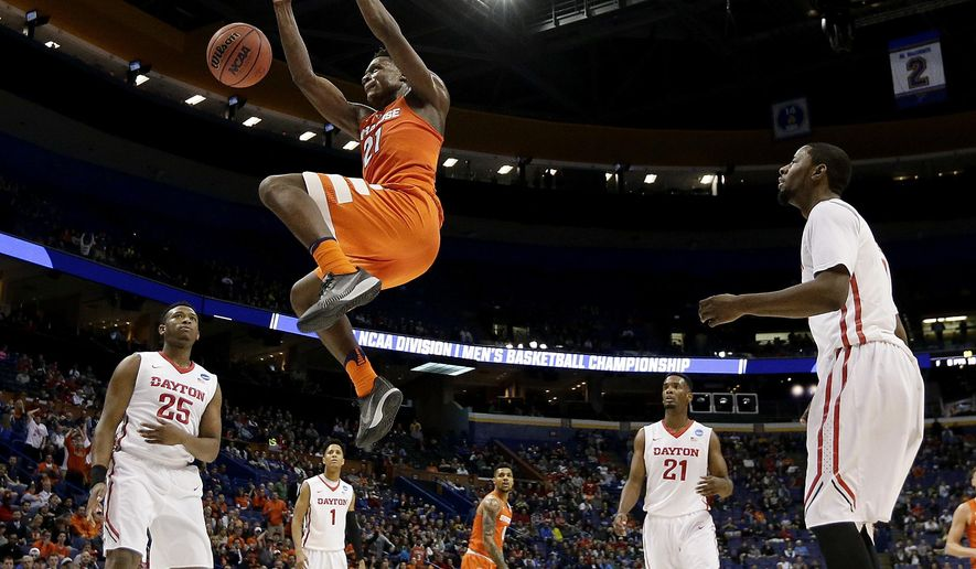 Syracuse's Tyler Roberson dunks the ball during the first half of a first-round men's college basketball game against Dayton in the NCAA Tournament, Friday, March 18, 2016, in St. Louis. (AP Photo/Charlie Riedel)