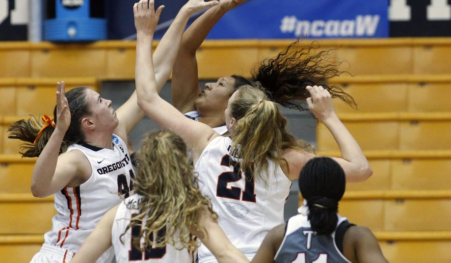 Oregon State' Ruth Hamblin, left, blocks the shot of Troy's Caitlyn Ramirez, center rear, in the first half of a game in the first round of a women's college basketball game in the NCAA Tournament in Corvallis, Ore., on Friday March 18, 2016 (AP Photo/Timothy J. Gonzalez)