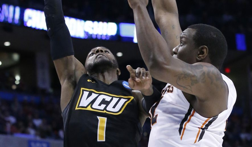 Virginia Commonwealth guard JeQuan Lewis (1) is fouled by Oregon State forward Jarmal Reid, right, as he shoots in the first half of a first-round men's college basketball game in the NCAA Tournament, Friday, March 18, 2016, in Oklahoma City. (AP Photo/Sue Ogrocki)