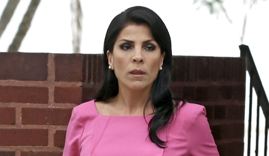 FILE - In this Nov. 13, 2012, file photo, Jill Kelley leaves her home in Tampa, Fla. Kelley's federal lawsuit over an investigation that led to the resignation of former CIA director David Petraeus is collapsing after her lawyers asked a judge March 18 to let them withdraw from the case. The lawyers cited irreconcilable differences, just weeks after the Justice Department declined a secret $4.35 million settlement proposal.  (AP Photo/Chris O'Meara, File)