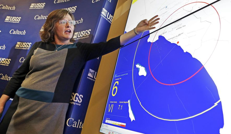 FILE - This Jan. 28, 2013 file photo Seismologist, Dr. Lucy Jones, describes how an early warning system would provide advance warning of an earthquake, at a news conference at the California Institute of Technology in Pasadena, Calif. Jones, the face of earthquake science and safety in Southern California, is retiring from the U.S. Geological Survey. Jones said in a Twitter posting Friday, March 18, that she's leaving federal service but will remain at the California Institute of Technology. (AP Photo/Reed Saxon,File)