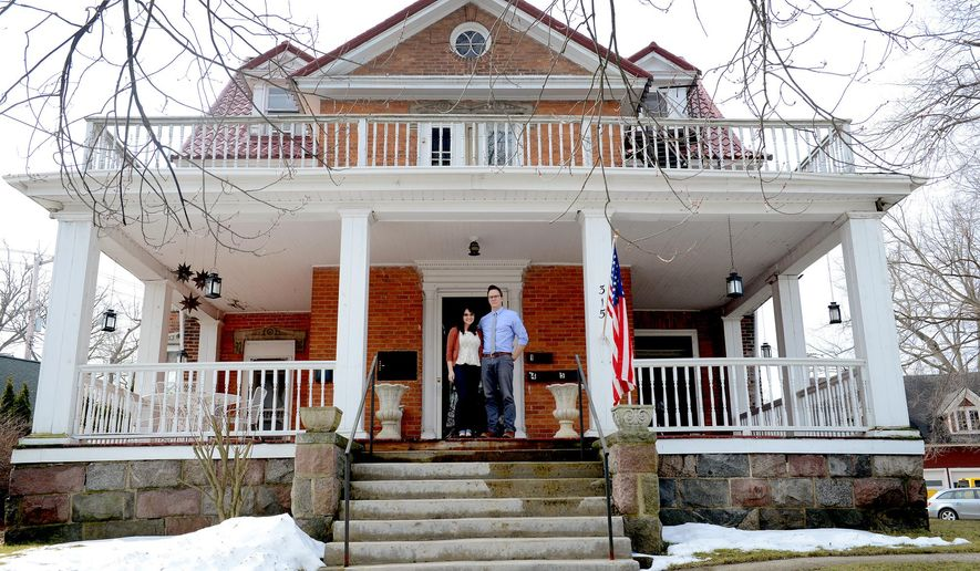 In 2014 Brittany and Dave Rademacher, seen in a March 8, 2016 photo, bought the 143-year-old house in Grand Ledge that was once the home of Edward A. Turnbull, the owner of the Grand Ledge Chair Company and delegate to the Michigan Constitutional Convention of 1907 to 1908 from Eaton County. The couple plans on spending the next 10-20 years renovating the 6,150 square foot house. (Dave Wasinger/Lansing State Journal via AP)