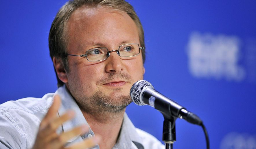 """FILE - In this Sept. 6, 2012 file photo, writer-director Rian Johnson speaks about his movie """"Looper"""" during a news conference at the 2012 Toronto International Film Festival in Toronto. A former agent for the director of the next """"Star Wars"""" film is suing claiming he was cut out of negotiations regarding the blockbuster franchise. Agent Brian Dreyfuss sued  Johnson in Los Angeles Superior Court on Friday March 18, 2016, seeking 10 percent of the director's """"Star Wars"""" earnings. (AP Photo/The Canadian Press, Aaron Vincent Elkaim, File)"""
