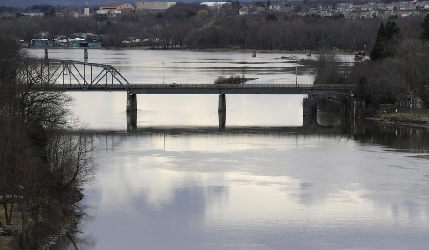 The Route 146 bridge spans the Mohawk River on Thursday, March 17, 2016, in Rexford, N.Y. As an exceptionally warm winter winds down, snowpack is scant around many Northeast mountains. Spring runoff from that snow is normally crucial for maintaining water levels on rivers and reservoirs, but late-winter rain is doing the job of melting snow in many areas, so far.  (AP Photo/Mike Groll)