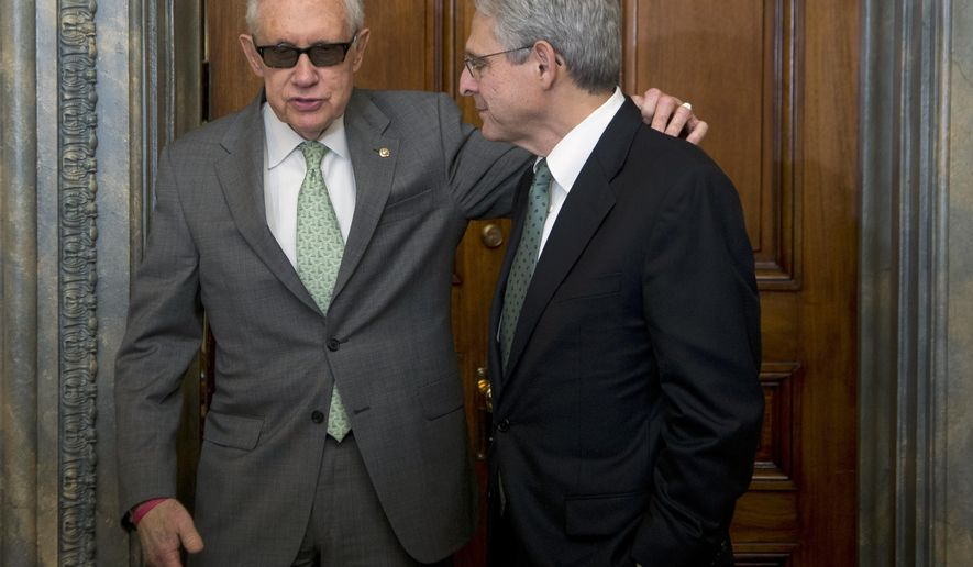 Senate Minority Leader Harry Reid, D-Nev., left, puts his arm around Supreme Court nominee Merrick Garland during a meeting in his office on Capitol Hill in Washington, Thursday, March 17, 2016.  (AP Photo/Manuel Balce Ceneta)