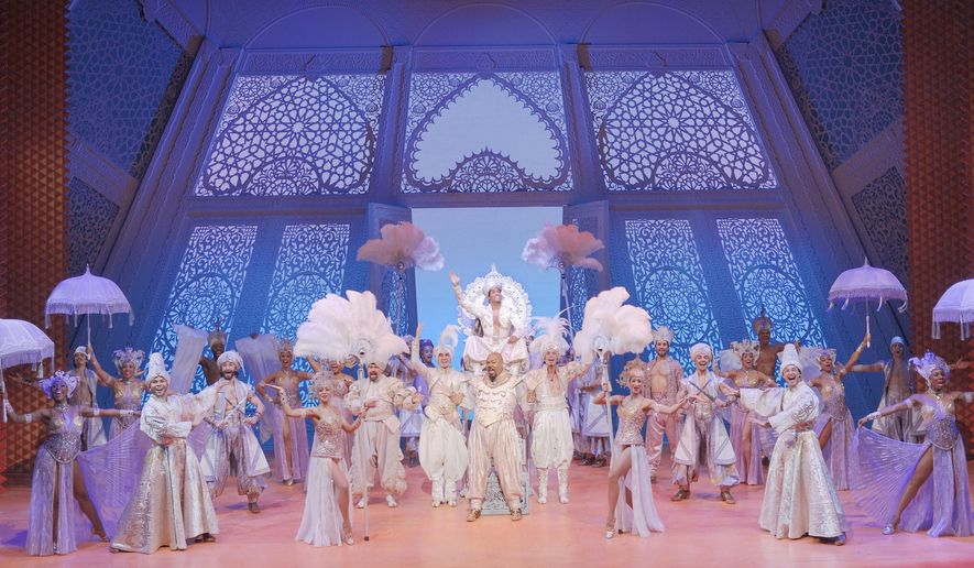 """This image released by Disney Theatrical Productions shows the cast during the """"Prince Ali,"""" number in the musical, """"Aladdin,"""" in New York. Disney Theatrical Productions said Friday, March 18, 2016, that Tony Award-winner James Monroe Iglehart, who plays the Genie, extended his contract through February 2017. Six other leading actors will also be remaining. (Deen van Meer/Disney Theatrical Productions via AP)"""