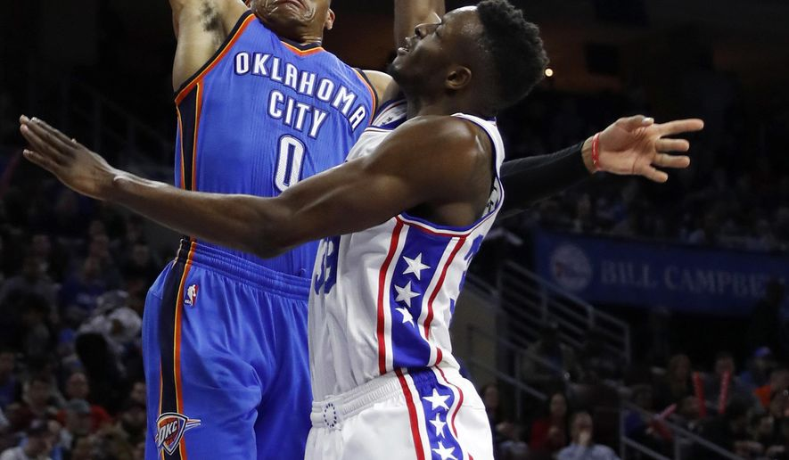 Oklahoma City Thunder's Russell Westbrook, left, goes up for a dunk against Philadelphia 76ers' Jerami Grant during the first half of an NBA basketball game, Friday, March 18, 2016, in Philadelphia. (AP Photo/Matt Slocum)