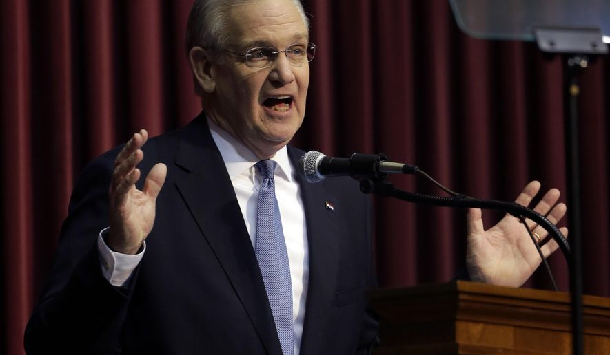 File- This Jan. 20. 2016, file photo shows Missouri Gov. Jay Nixon delivering the annual State of the State address to a joint session of the House and Senate in Jefferson City, Mo. Nixon on Friday, March 18, 2016, vetoed legislation requiring public employees to annually reauthorize paying their union dues through paycheck withholdings, setting up a confrontation with Republican leaders who say they have enough votes to overrule him. (AP Photo/Jeff Roberson, File)