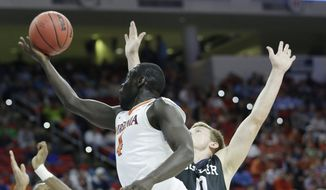 Virginia guard Marial Shayok (4) shoots against Butler forward Austin Etherington (0) during the first half of a second-round men's college basketball game in the NCAA Tournament, Saturday, March 19, 2016, in Raleigh, N.C. (AP Photo/Chuck Burton)