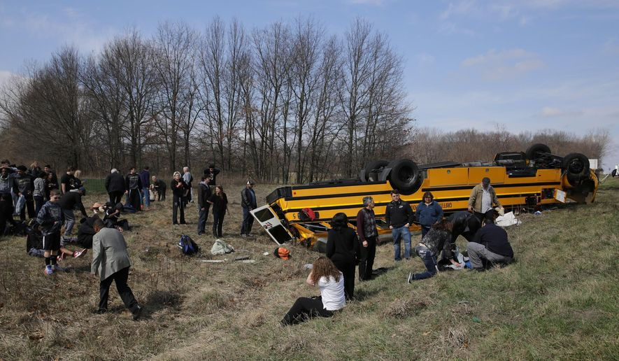 people on the scene of a school bus accident attend to the injured after the bus carrying. Black Bedroom Furniture Sets. Home Design Ideas