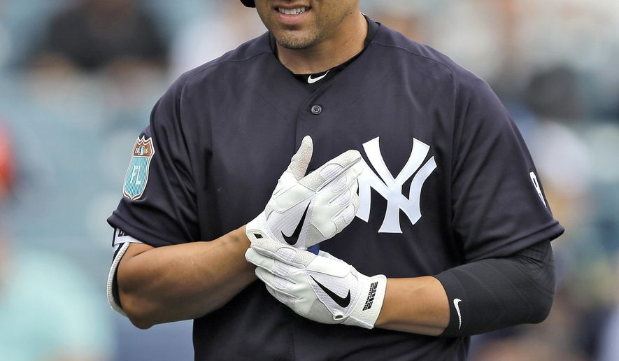 New York Yankees' Jacoby Ellsbury grimaces after being hit with a pitch from Atlanta Braves' Julio Teheran during the fifth inning of a spring training baseball game Saturday, March 19, 2016, in Tampa, Fla. Ellsbury left the game. (AP Photo/Chris O'Meara)
