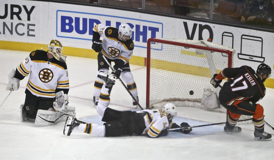 Anaheim Ducks center Ryan Kesler slaps in a goal as Boston Bruins goalie Jonas Gustavsson is caught out of position and defenseman Dennis Seidenberg dives for the puck during the first period of an NHL hockey game Friday, March 18, 2016, in Anaheim, Calif. (AP Photo/Lenny Ignelzi)