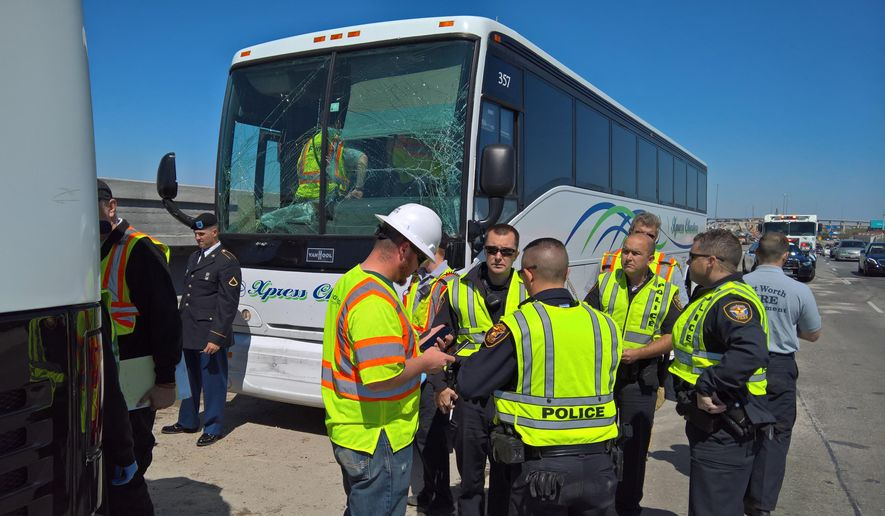 This photo provided by Matt Zavadsky with MedStar EMS shows law enforcement at the scene of a accident on Saturday, March 19, 2016 in Fort Worth, Texas.  Officials say 10 people have been slightly hurt when two charter buses transporting military personnel from Oklahoma were part of a three-vehicle wreck in Texas. MedStar EMS spokesman Matt Zavadsky says the accident happened Saturday morning on southbound Interstate 35 in Fort Worth. He says the buses were hauling uniformed personnel from Fort Still, Oklahoma, to Fort Sam Houston, in San Antonio.  (Matt Zavadsky via AP