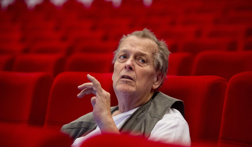 FILE - In this July 11, 2015 file photo Czech film director Jan Nemec sits in the Big Hall of the Thermal Hotel in Karlovy Var, Czech Republic,  during shooting his movie 'The Wolf from Royal Vineyard Street'. Film director Jan Nemec, a representative of the new wave of Czechoslovak cinema in the 1960s has died. He was 79. Czech public television, citing his wife, says Nemec died Friday, March 18, 2016. (Vit Simanek/CTK via AP) ** SLOVAKIA OUT