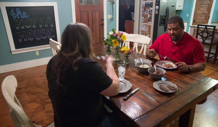 Reese Hoffa, who plans to compete for a spot on the U.S. Olympic team at the Olympic games in Rio De Janeiro, and his wife Renata Hoffa share a meal at their home, Wednesday, March 16, 2016, in Athens, Ga. The Hoffas, who are trying to have children, are rethinking the both of them making the trip to Rio as the Zika virus continues to threaten women who are pregnant.  (Branden Camp/Atlanta Journal-Constitution via AP)  MARIETTA DAILY OUT; GWINNETT DAILY POST OUT; LOCAL TELEVISION OUT; WXIA-TV OUT; WGCL-TV OUT; MANDATORY CREDIT