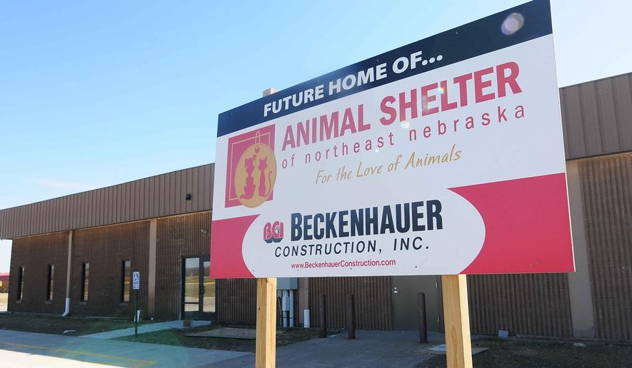 ADVANCE FOR THE WEEKEND OF MARCH 19-20 AND THEREAFTER - A March 9, 2016 photo advertises the Animal Shelter of Northeast Neb., in Norfolk, Neb. With an extensive foster system, the Animal Shelter of Northeast Nebraska has operated for years with no central location. That is no longer the case for the organization. part of the building previously used as a chicken hatchery underwent a major renovation to bring it up-to-date and make it a functional shelter space.  (Jake Wragge/Norfolk Daily News via AP) 3/9/16