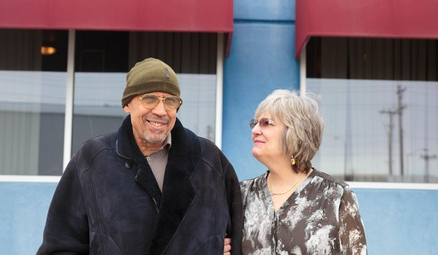 ADVANCE FOR SATURDAY MARCH 19 AND THEREAFTER - In a Feb. 16, 2016 photo, Shadi and Becky Aboushady stand in front of Bella Italia, their Italian restaurant, in Cozad, Neb. Aboushady is trying to sell Bella Italia, their Italian restaurant in Cozad because he has undergone a number of heart surgeries.  (Matt Miller/The World-Herald via AP)