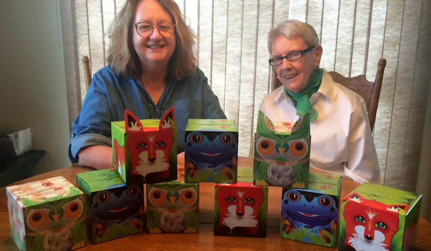 Barb Luhring, left, of Sister Bay and her 85-year-old mother, Alice Baryenbruch of Suamico, created Sniffles Pals facial tissues, sold in animal-themed boxes. Featuring a fox, frog or owl, Sniffles Pals is available at all Festival Foods stores in Wisconsin as well as locations in Door County and online. (Todd McMahon/The Green Bay Press-Gazette via AP)