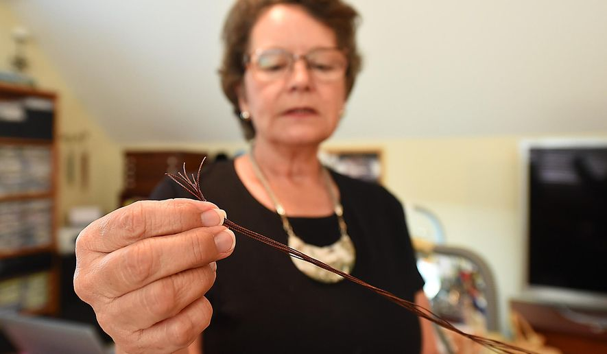 In this March 8, 2016 photo, Diane Rodenhizer, of Enterprise, Ala., talks about the technique of kumihimo braiding, which uses eight strands of string, to create her jewelry. (Jay Hare/Dothan Eagle via AP) MANDATORY CREDIT
