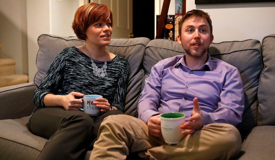In this March 4, 2016, photo, Brennan Byrd and Andrew Byrd pose for a photo on their couch in Lexington, Ky. The two University of Kentucky linguists led a team who created, and taught actors to speak, the innovative language Wenja with its roots long ago and far away, specifically Proto-Indo-European used between approximately 4,500 and 2,500 B.C. (Charles Bertram/Lexington Herald-Leader via AP) MANDATORY CREDIT