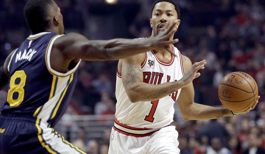Chicago Bulls guard Derrick Rose, right, looks to pass against Utah Jazz guard Shelvin Mack during the first half of an NBA basketball game Saturday, March 19, 2016, in Chicago. (AP Photo/Nam Y. Huh)