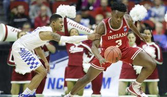 Indiana forward OG Anunoby, right, is fouled by Kentucky guard Tyler Ulis after stealing the ball during the first half of a second-round men's college basketball game in the NCAA Tournament, Saturday, March 19, 2016, in Des Moines, Iowa. (AP Photo/Charlie Neibergall)