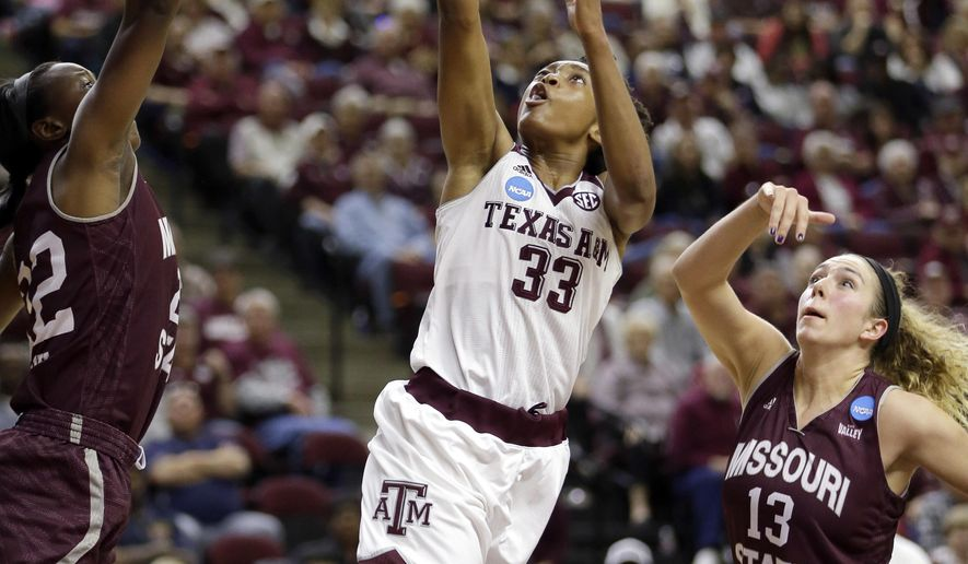 Texas A&M's Courtney Walker (33) shoots as Missouri State's Audrey Holt (13) and Tyonna Snow defend during the second half of a first-round women's college basketball game in the NCAA Tournament Saturday, March 19, 2016, in College Station, Texas. Texas A&M won 74-65.(AP Photo/David J. Phillip)