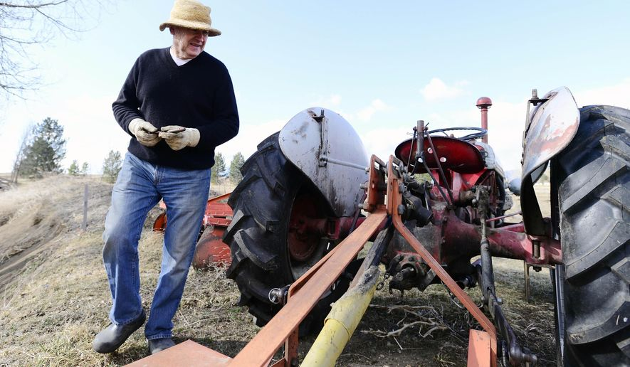 ADVANCE FOR WEEKEND EDITIONS MARCH 19-20 - In this March 8, 2016 photo, Bob Poley, of Hoot 'n' Howl Farm, a market farm off Jay Road gets his Ford tractor ready for weed cutting in Boulder, Colo. (Cliff Grassmick/Daily Camera via AP) NO SALES; MANDATORY CREDIT