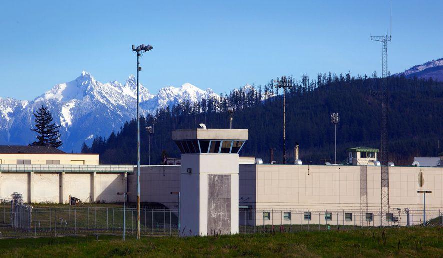This photo taken Feb. 23, 2016 shows the Monroe Correctional Complex in Monroe, Wash., where Barry and Rhonda Massey met at when he was an inmate and she a corrections officer. The two were married in 2009 and now live five minutes from the prison.  (Ellen M. Banner/The Seattle Times via AP)