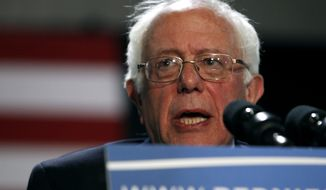 Democratic presidential candidate Sen. Bernie Sanders, I-Vt., speaks at a campaign rally, Saturday, March 19, 2016 in Phoenix. (AP Photo/Ralph Freso)