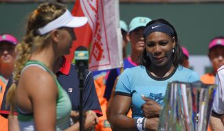 Victoria Azarenka, left, of Belarus, speaks to Serena Williams after a final at the BNP Paribas Open tennis tournament, Sunday, March 20, 2016, in Indian Wells, Calif. Azarenka won 6-4, 6-4. (AP Photo/Mark J. Terrill)