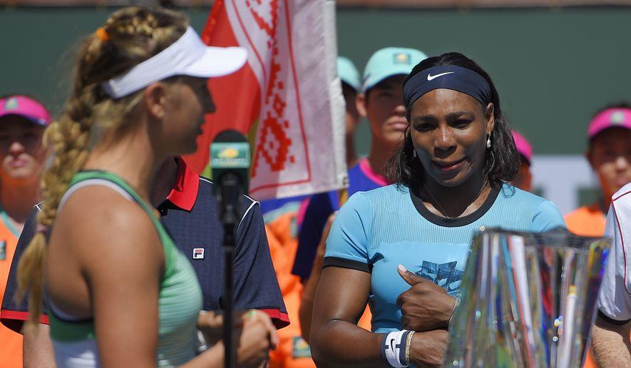 Victoria Azarenka, left, of Belarus, speaks to Serena Williams after a final at the BNP Paribas Open tennis tournament, Sunday, March 20, 2016, in Indian Wells, Calif. Azarenka won 6-4, 6-4. (AP Photo/Mark J. Terrill)