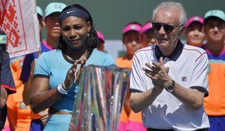 Serena Williams stands with tournament director Raymond Moore after Victoria Azarenka, defeated Williams in a final at the BNP Paribas Open tennis tournament, Sunday, March 20, 2016, in Indian Wells, Calif. Azarenka won 6-4, 6-4. (AP Photo/Mark J. Terrill)