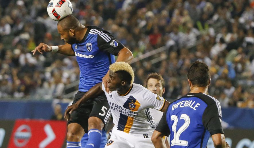 San Jose Earthquake's Victor Bernardez gets over Los Angles Galaxy's Gyasi Zerdes clearing the ball from in front of the Earthquake's net during the first half of a MLS soccer game Saturday, March 19, 2016, in Carson, Calif. (AP Photo/Lenny Ignelzi)