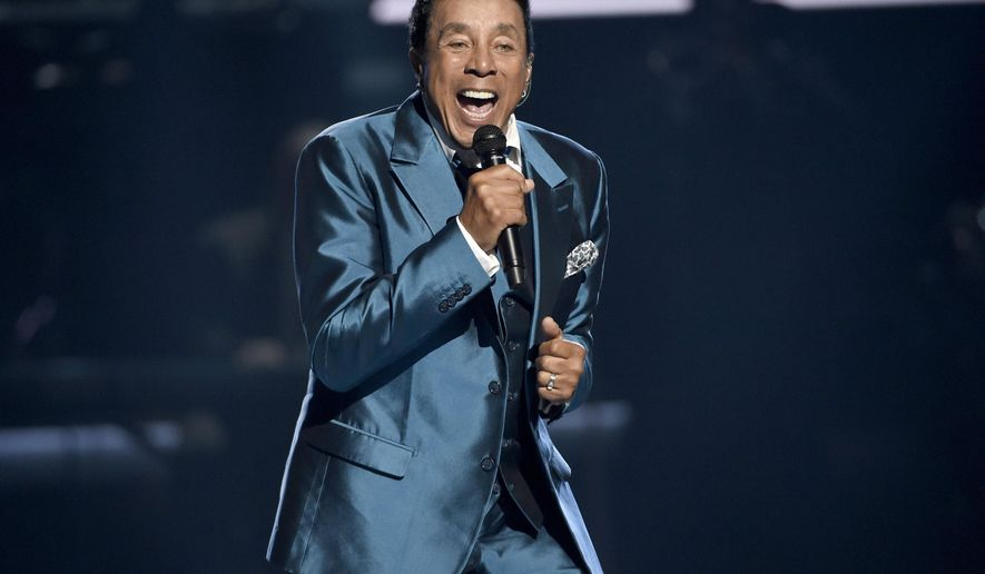FILE - In this June 28, 2015, file photo, Smokey Robinson performs at the BET Awards in Los Angeles. Robinson will be honored on May 19, 2016, by the MusiCares MAP Fund, which provides members of the music community access to addiction recovery treatment regardless of their financial situation. Robinson will also perform at the event, to be hosted by comedian-actor Cedric the Entertainer. Additional performers will be announced at a later date. (Photo by Chris Pizzello/Invision/AP, File)