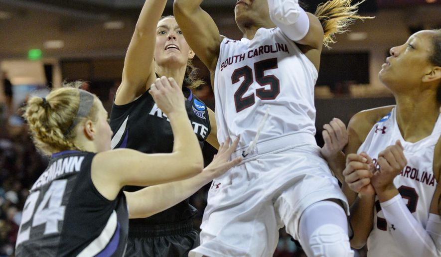 South Carolina's Tiffany Mitchell (25) shoots while defended by Kansas State's Kindred Wesemann, (24) and Kaylee Page during the first half of a second-round women's college basketball game in the NCAA Tournament Sunday, March 20, 2016, in Columbia, S.C.  (AP Photo/Richard Shiro)