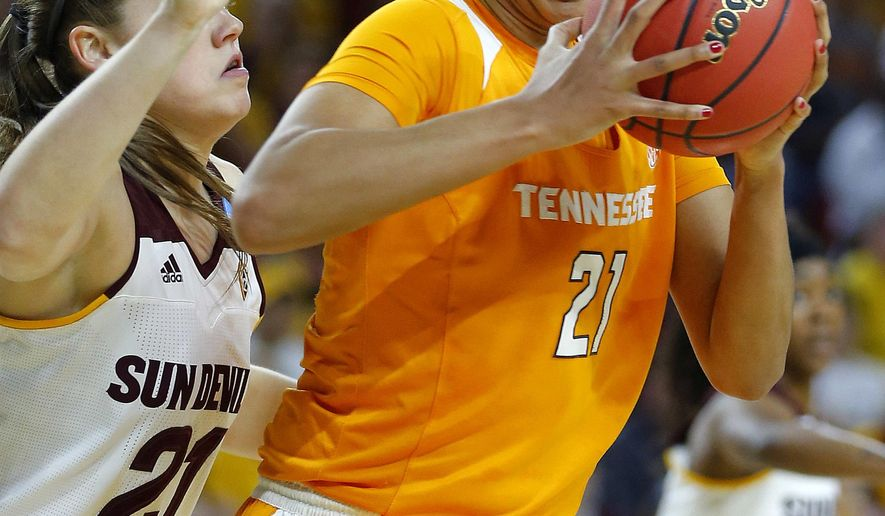 Tennessee center Mercedes Russell (21) backs down Arizona State forward Sophie Brunner (21) during the first half of a second-round women's college basketball game in the NCAA Tournament on Sunday, March 20, 2016, in Tempe, Ariz. (AP Photo/Matt York)