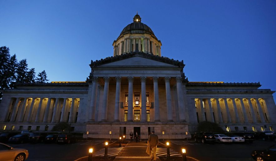 FILE - In this March 10, 2016, file photo, the Legislative Building is shown at dusk at the Capitol in Olympia, Wash. While lawmakers continue to grapple over finalizing a supplemental budget during an overtime special session this year, one point of disagreement is whether the Legislature should combat a shortage that appears to be mostly of math, science and special education teachers by raising the state's portion of the lowest beginning salary for teachers to $40,000 from $35,700. (AP Photo/Ted S. Warren, File)