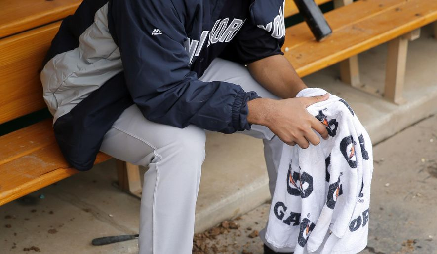 New York Yankees starting pitcher Ivan Nova sits in the dugout in the third inning of a spring training baseball game against the Minnesota Twins, Sunday, March 20, 2016, in Fort Myers, Fla. (AP Photo/Tony Gutierrez)