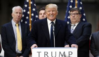 Republican presidential candidate Donald Trump speaks during a campaign event in the atrium of the Old Post Office Pavilion, soon to be a Trump International Hotel, Monday, March 21, 2016, in Washington. (AP Photo/Alex Brandon)