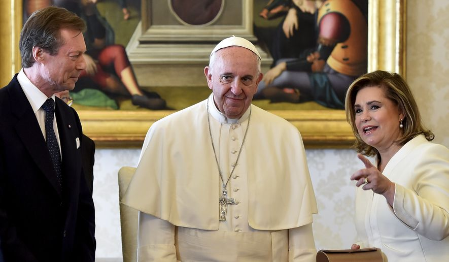 Pope Francis poses with Luxembourg's Grand Duke Henri, left, and his wife Grand Duchess Maria Teresa on the occasion of their private audience at the Vatican, Monday, March 21, 2016. (Gabriel Bouys/Pool Photo via AP)