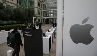 The exterior of Apple headquarters is seen before an event to announce new products at the company's headquarters Monday, March 21, 2016, in Cupertino, Calif. (AP Photo/Marcio Jose Sanchez) **FILE**