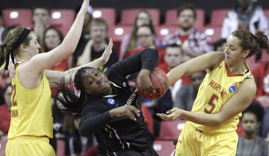 Washington forward/center Chantel Osahor, center, becomes entangled with Maryland forward Tierney Pfirman, left, and center Malina Howard as she tries to maintain possession in the first half of an NCAA college basketball game in the second round of the NCAA tournament, Monday, March 21, 2016, in College Park, Md. (AP Photo/Patrick Semansky)