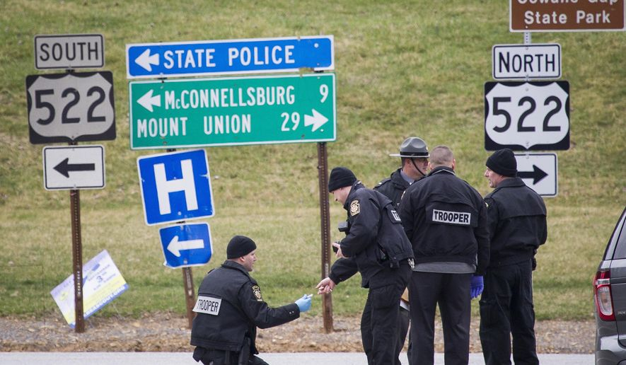 Police investigate at exit 180 off of the Pennsylvania Turnpike, Sunday, March 20, 2016, in Fort Littleton, Pa. A retired state trooper killed a turnpike toll collector and a security guard in a holdup attempt at a toll plaza and then was shot dead by troopers while trying to escape with the money, authorities said. (Daniel Zampogna/PennLive.com via AP) MANDATORY CREDIT; MAGS OUT