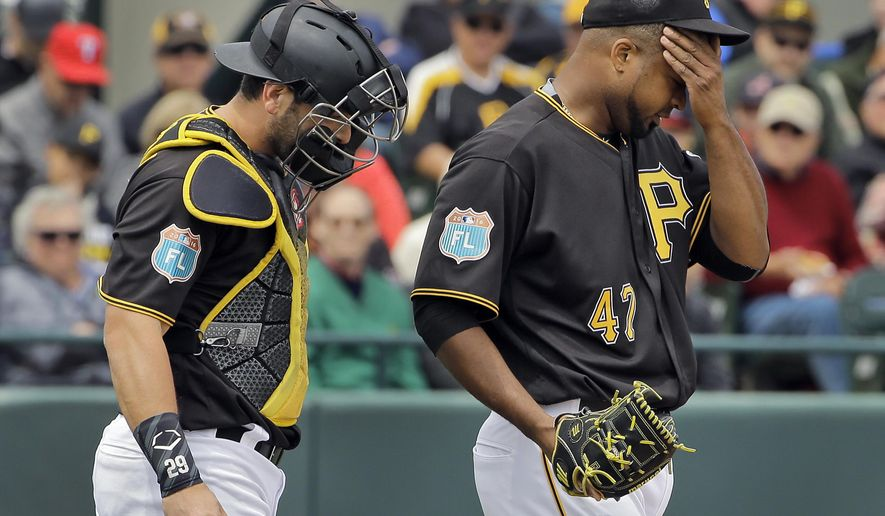 Pittsburgh Pirates starting pitcher Francisco Liriano, right, wipes his forehead after walking Atlanta Braves' Jhoulys Chacin during the second inning of a spring training baseball game Monday, March 21, 2016, in Bradenton, Fla. Pirates catcher Francisco Cervelli, left, looks on. (AP Photo/Chris O'Meara)